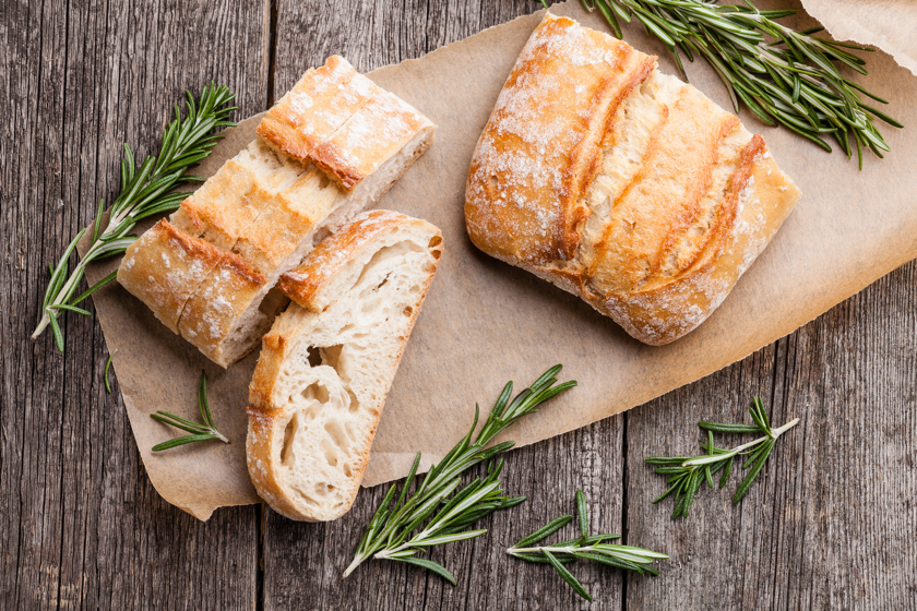 Sliced loaf of bread and rosemary